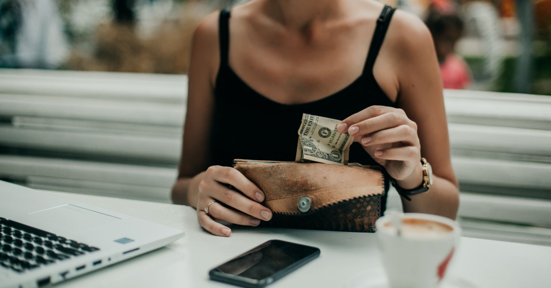Paying with cash can help you lose weight and save money—but fewer Americans are doing it