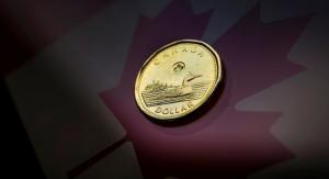 Loonie weakens as oil slides, trade war fears grow